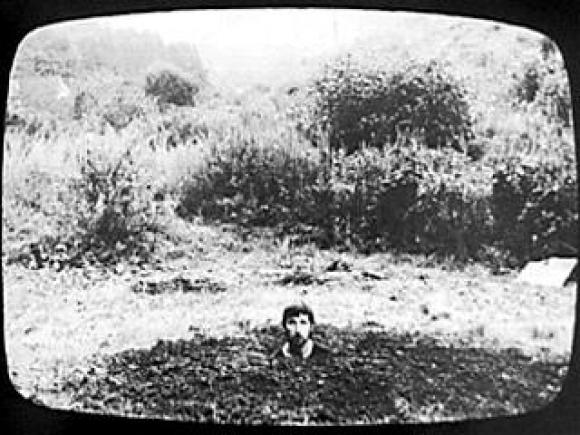 Keith Arnatt, Self Burial, 1969