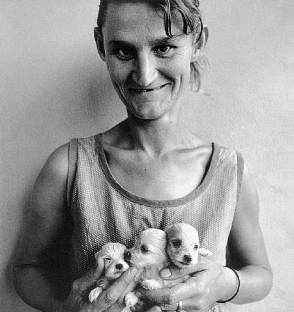 Roger Ballen, Platteland, Wife of Abbatoir Worker, Holding Three Puppies, Orange